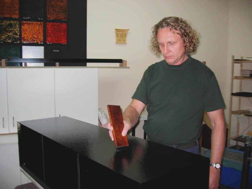 Sergej brushing on the urushi lacquer